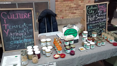 Farmers market booth (source: Culture City)